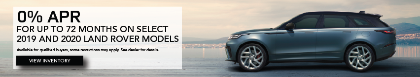Grey 2020 Range Rover Velar on road near lake. 0% APR up to 72 months on select 2019 and 2020 Land Rover models. Some restrictions may apply. See dealer for complete details.