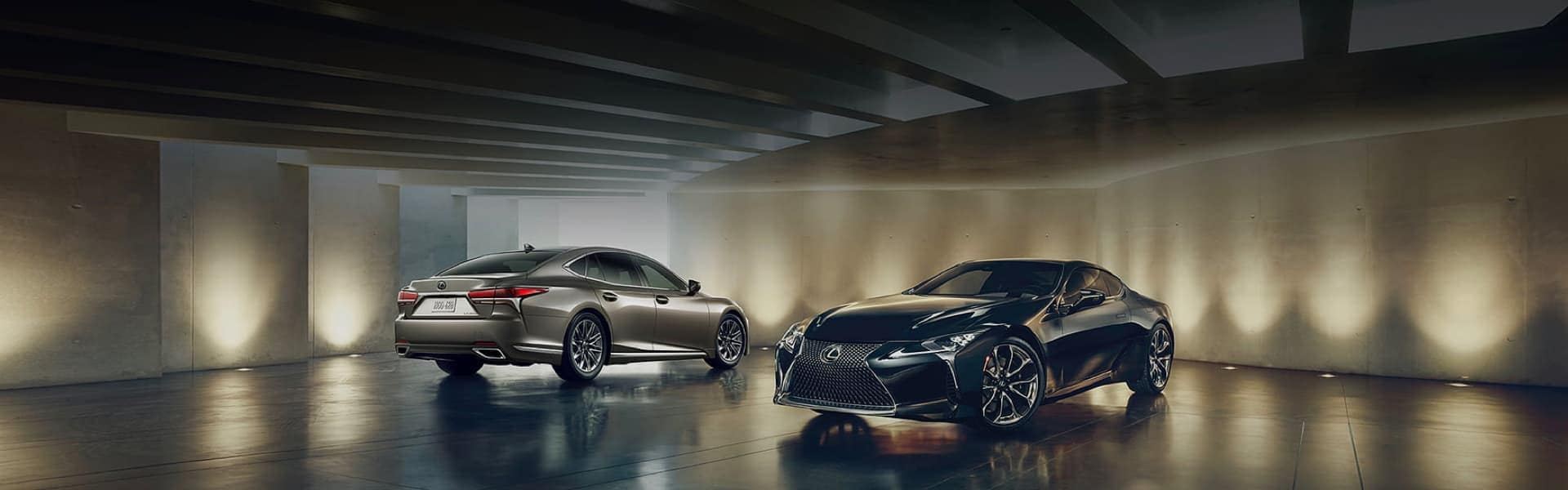 Two Lexus vehicles parked in a concrete showcase area with a highly reflective floor