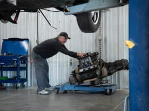 Technician with Engine