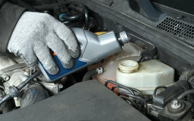 brake fluid being topped off