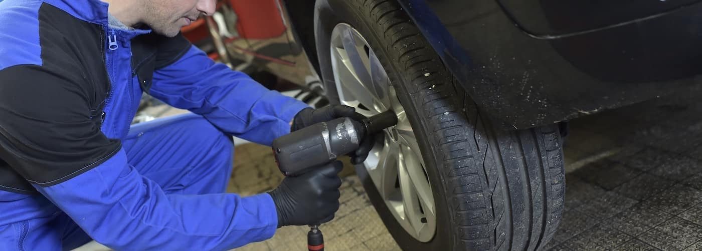 mechanic-working-on-tire-rotation_67894641