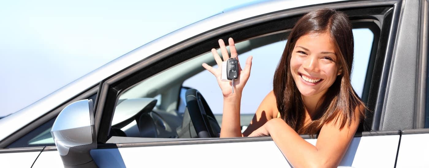 happy woman in a car