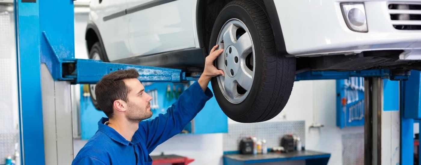 man-examining-tires