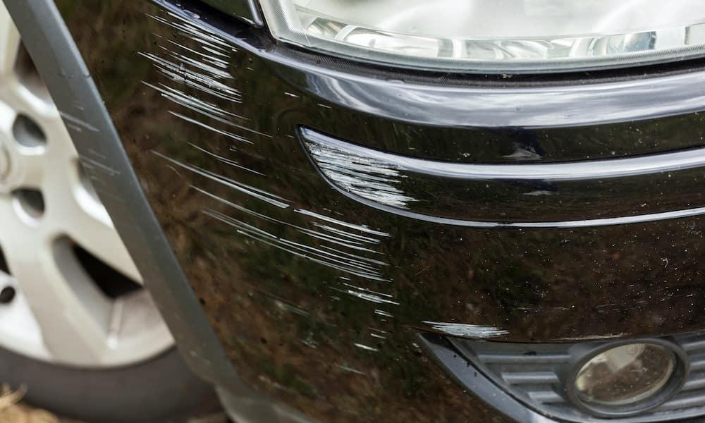 Scratched car bumper