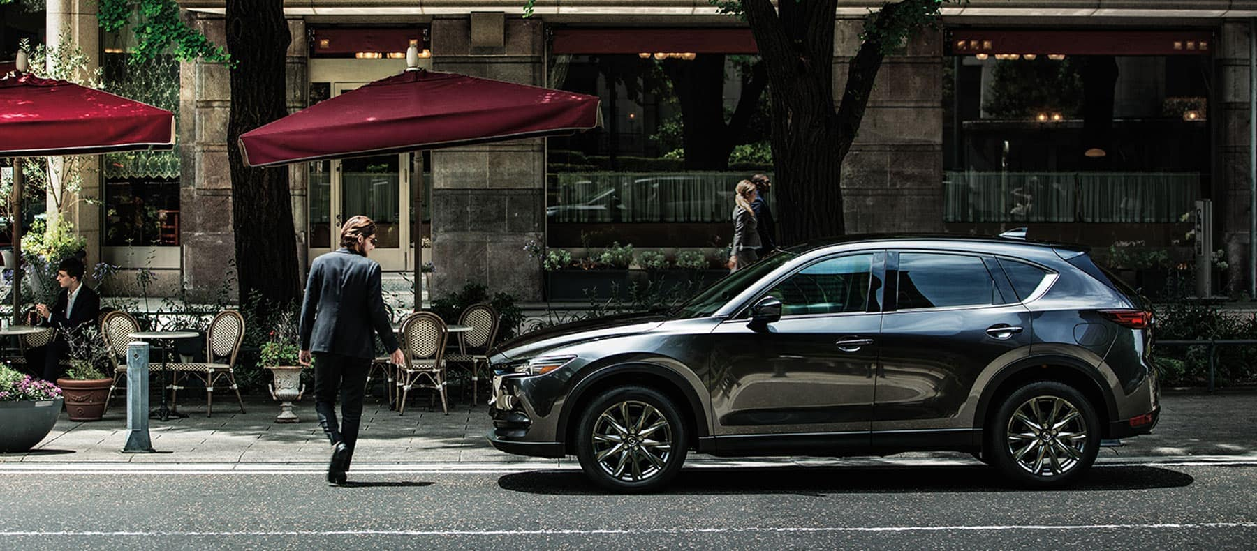 Mazda CX-5 sitting on the side of a city street