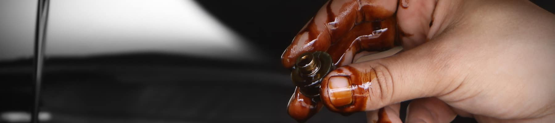 Close up of hand inspecting oil