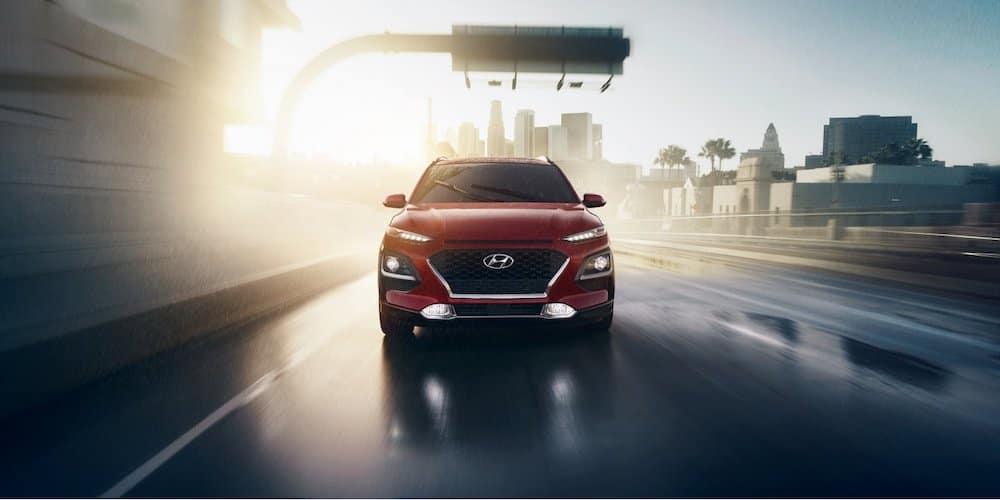 Red 2020 Hyundai Kona on Rainy Road