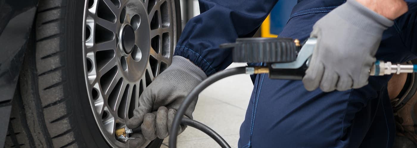 Technician Filling Up Car Tire