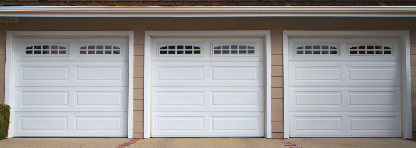 row of three white garage doors