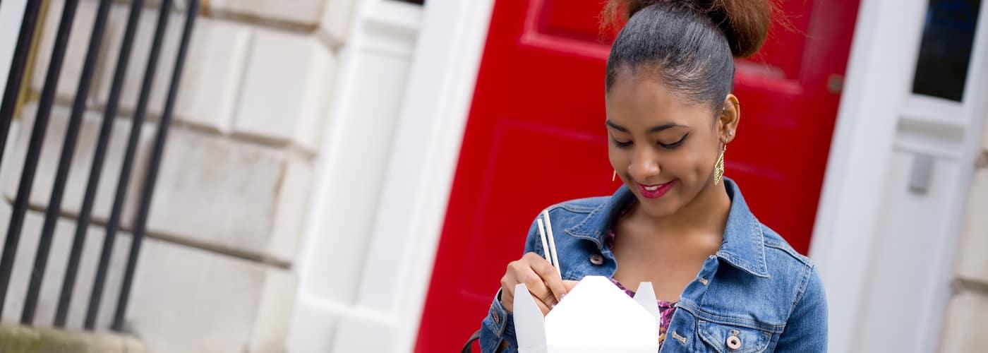 Young Woman Enjoying Takeout Food
