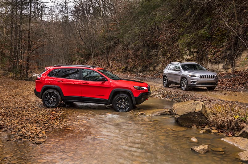 Winners Circle CDJR is a Car Dealership in Hampton VA | Two 2020 JEEP Cherokees by the creek